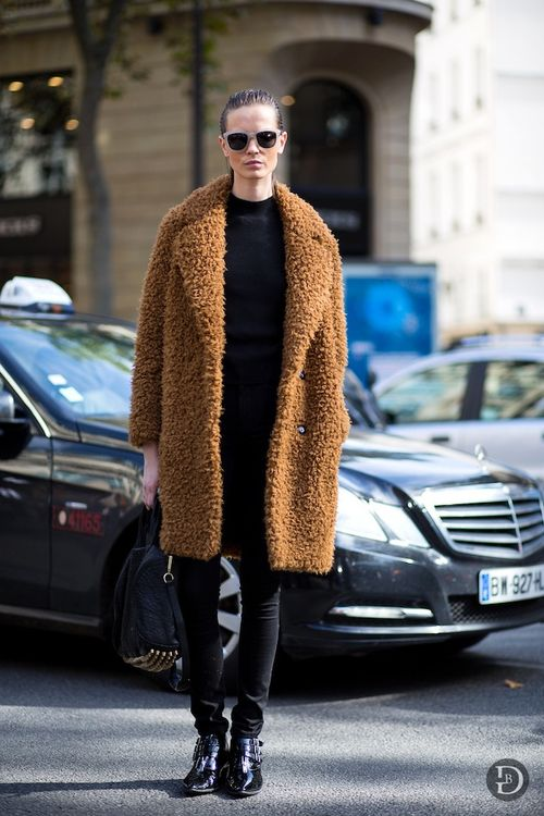 Le-Fashion-Blog-Model-Off-Duty-Street-StyleMina-Cvetkovic-Furry-Camel-Coat-Sandro-Faux-Teddy-Skinny-Black-Jeans-Buckled-Boots-The-Urban-