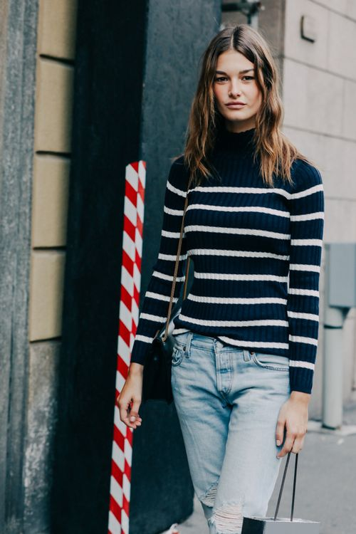 Le-Fashion-Blog-Ophelie-Guillermand-Milan-Fashion-Week-Model-Off-Duty-Spring-Summer-Street-Style-Navy-And-Cream-Striped-Turtleneck-Sweater-Light-Wash-Distressed-Boyfriend-Jeans-Via-Vog